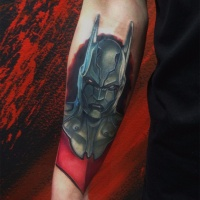 Batman head tattoo on forearm