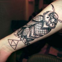 Beautiful black-and-white owl with triangle tattoo for guys on forearm