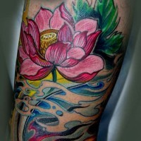 Beautiful japanese lotus flower in waves tattoo on arm