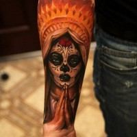 Beautiful mens colorful muerte girl tattoo on forearm