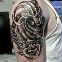 Beautiful ram head with stars and rose tattoo for men on upper arm