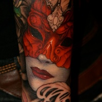 Beautiful woman in red mask tattoo