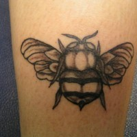 Fat black and white bee tattoo