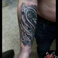 Biomechanical tattoo on forearm