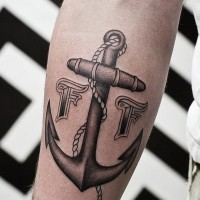Black-and-white roped anchor with signs tattoo for men on forearm