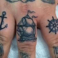 ancora nera tatuaggio su dito anuale