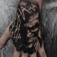 Black and white Joker tattoo on wrist