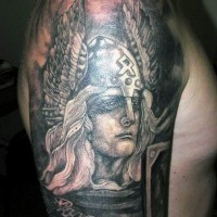 Black and white Viking warrior in winged helmet tattoo on shoulder