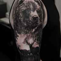 Black and white bear tattoo on shoulder