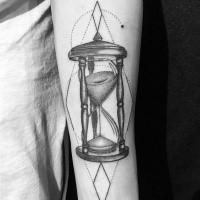 Black dotwork hourglass forearm tattoo