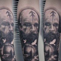 Black grey portrait of viking with ship tattoo