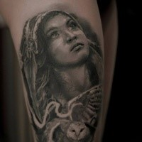 Black ink thigh tattoo of beautiful Indian woman portrait