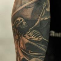 Black skeleton tattoo on forearm