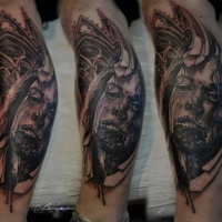 Bloody face and cathedral tattoo on arm