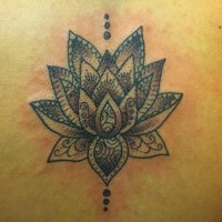 Classic black tribal lotus flower tattoo on back