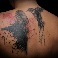 Colored large tattoo painted in trash polka style of microphone with lettering and hummingbird