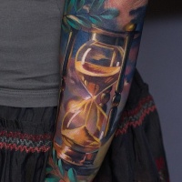 Colorful hourglass tattoo on forearm