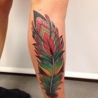 Colorful new school feather tattoo on arm