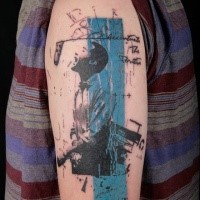 Colorful nice painted upper arm tattoo of man singer with lettering