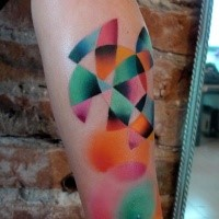 Colorful painted by Mariusz Trubisz forearm tattoo of geometrical ornaments