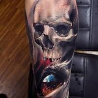 Cráneo colorido con el tatuaje del ojo de Wild Tattoo