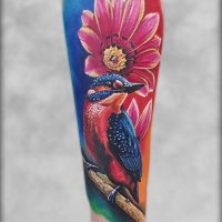 Colorfull girly tattoo with bird and flower