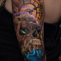 Colorfull skull and clock tattoo on arm