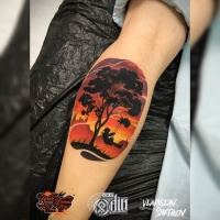Colorfull tree and child tattoo on forearm