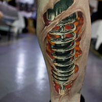 Cool biomechanical tattoo on leg