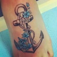 fresco nero e bianco ancora con fiori blu tatuaggio supiedi