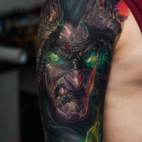 Cool demonic face tattoo on shoulder