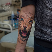 Cool leopard head tattoo on forearm