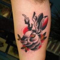Cool old school hare with deer horns tattoo on arm