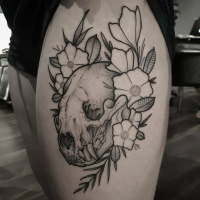 Cool skull and flowers tattoo on thight