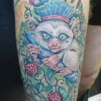 Crazy twisted lemur in cown tattoo on thigh