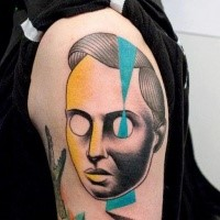 Creepy looking painted by Mariusz Trubisz upper arm tattoo of human like mask