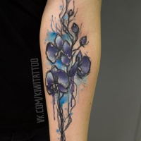 Cute flower tattoo on arm