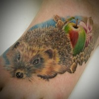 Cute girly color-ink hedgehog with fruit tattoo on foot