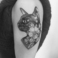 Cute girly tattoo with cat and flower