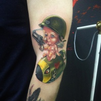 Cute military child tattoo on arm