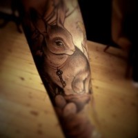 Cute natural looking very detailed animal bunny tattoo on arm