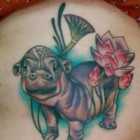 Cute old-school colorful hippo tattoo on thigh