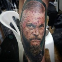 Detailed coloured viking tattoo