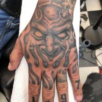 Devil tattoo on hand