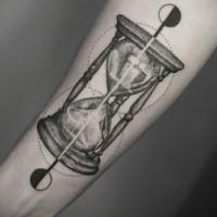 Dotwork hourglass forearm tattoo