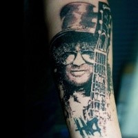Dotwork style black ink forearm tattoo of Slash portrait with guitar