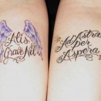 Double beautiful-lettered quote with wings and stars tattoo on forearm