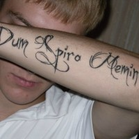 Dum spero mimini latin quote tattoo on arm