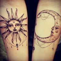 Elegant girly sun and moon tattoo on arm
