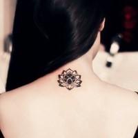 Elegant small lotus flower blossom tattoo on neck